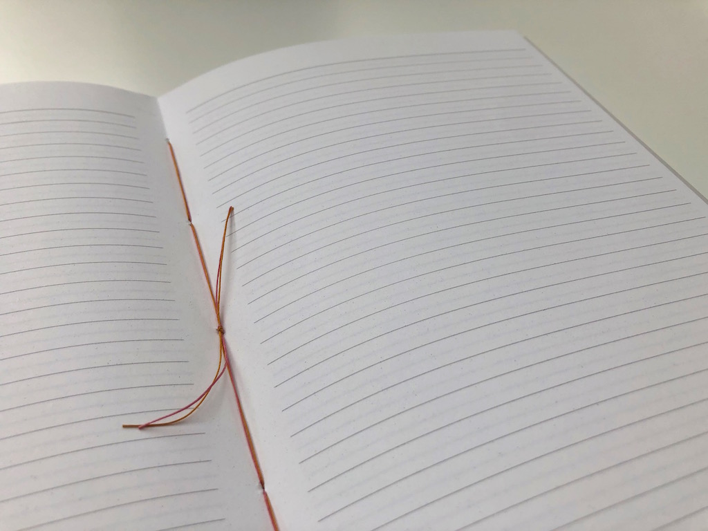 A notebook spread with lined paper.