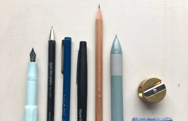 a selections of pens and pencils on a desk